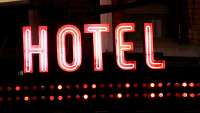 stock-footage-hotel-sign-with-flashing-lights